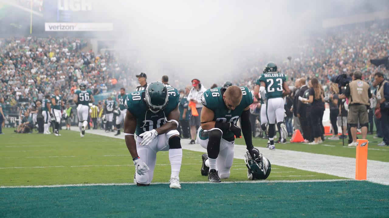Philadelphia Eagles Corey Clement (30) and Zach Ertz (86) kneel before an NFL football game against the Arizona Cardinals, Sunday, Oct. 8, 2017, in Philadelphia.