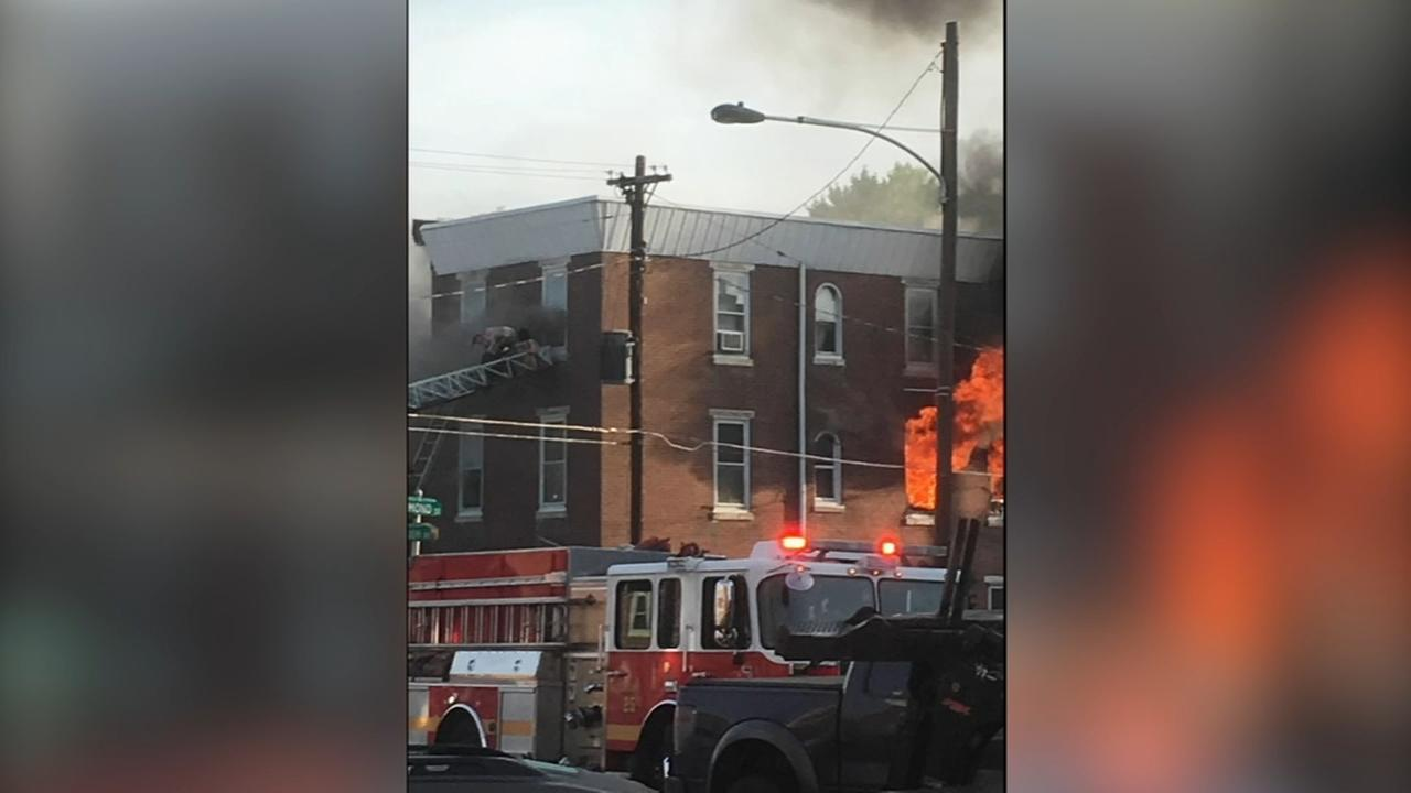 Firefighters rescue occupants of burning home