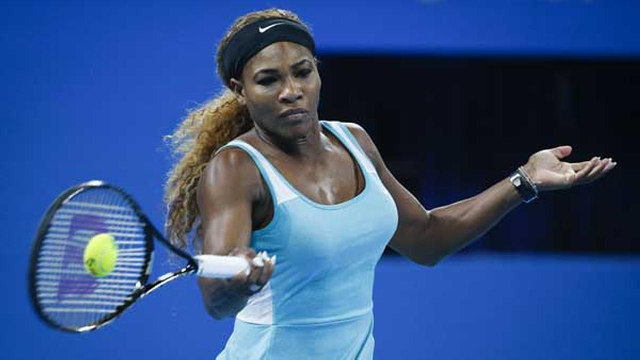 Serena Williams of the United States returns a shot during the China Open tennis tournament at the National Tennis Stadium in Beijing, China on Tuesday Sept. 30, 2014.
