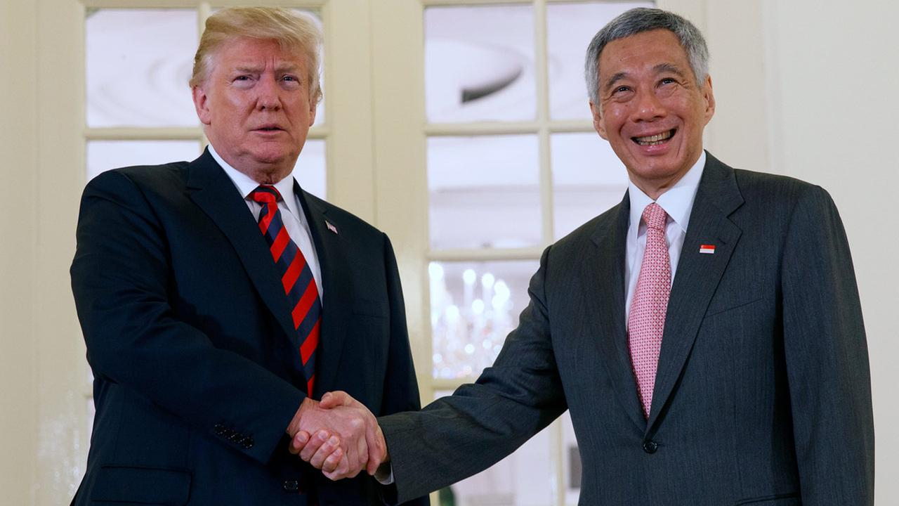 President Donald Trump shakes hands as he meets with Singapore Prime Minister Lee Hsien Loong ahead of a summit with North Korean leader Kim Jong Un, Monday, June 11, 2018.