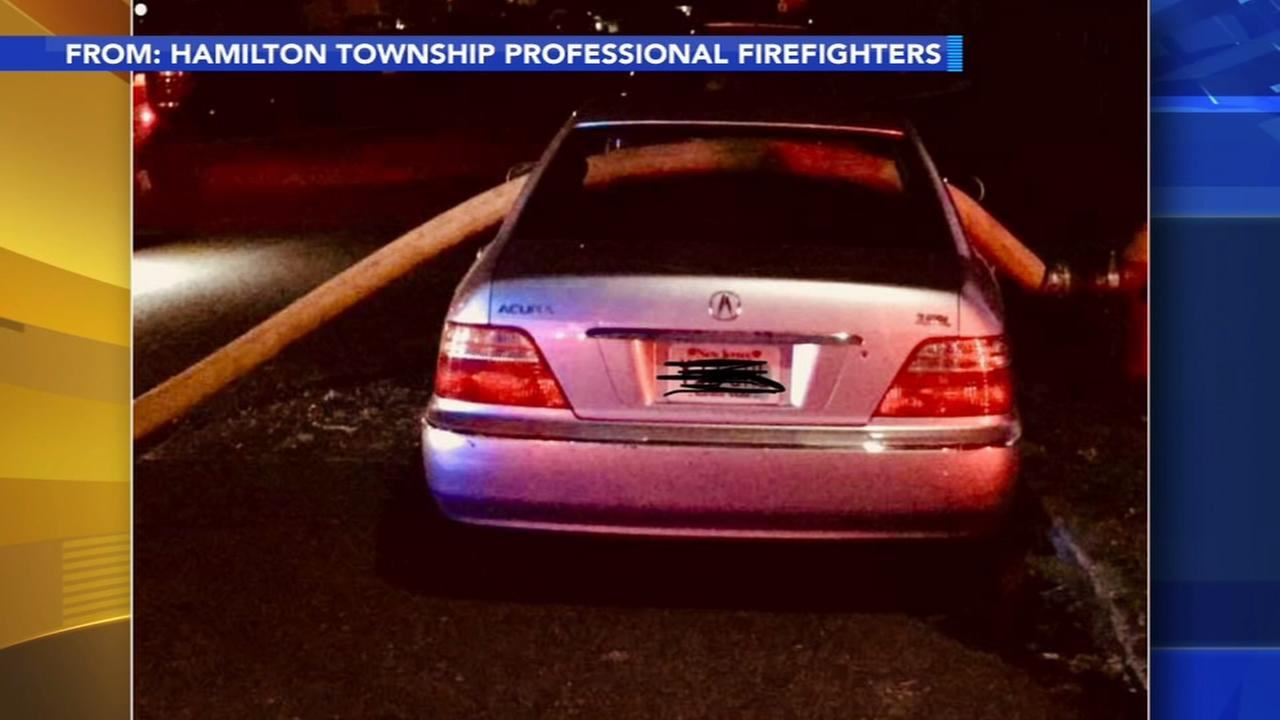 Firefighters break windows on car parked in front of hydrant