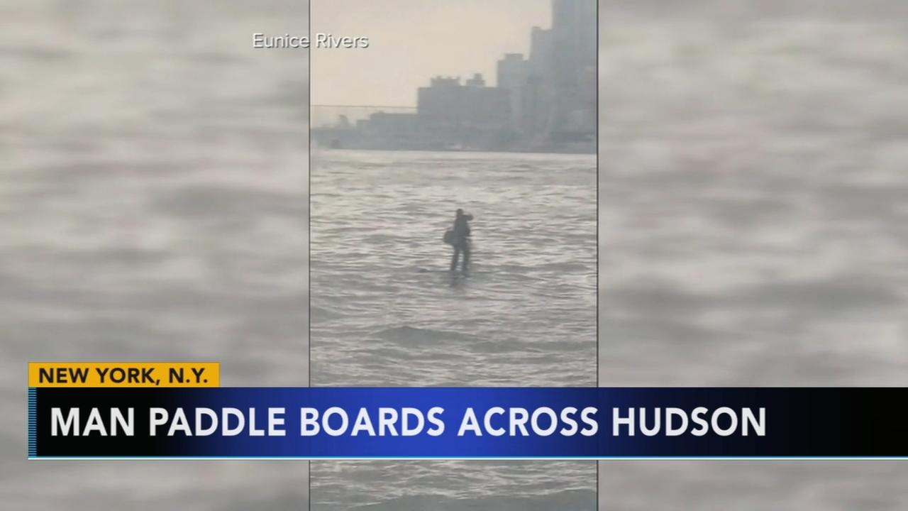 Man paddle boards across Hudson