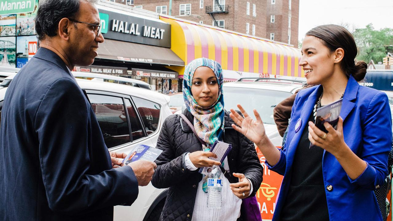 This May 6, 2018 photo provided by the Alexandria Ocasio-Cortez Campaign shows candidate Alexandria Ocasio-Cortez, right, during a Bengali community outreach in New York.