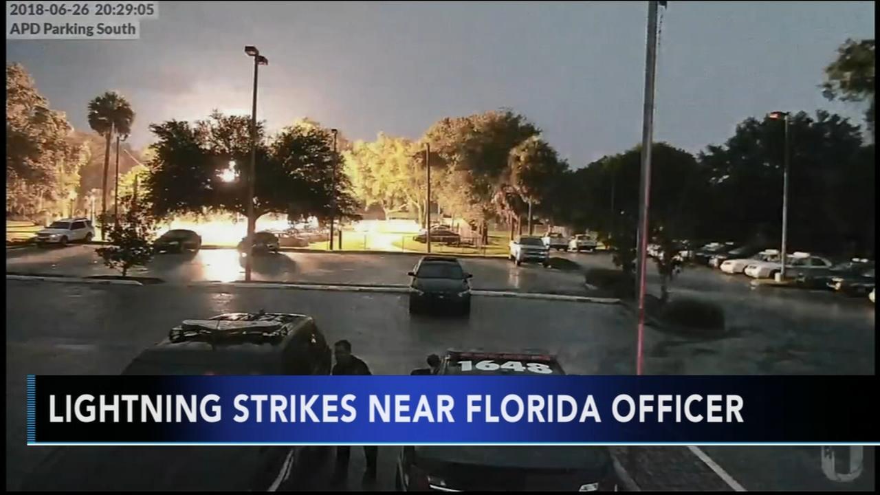 Shocking video: Lightning strikes behind Florida officer