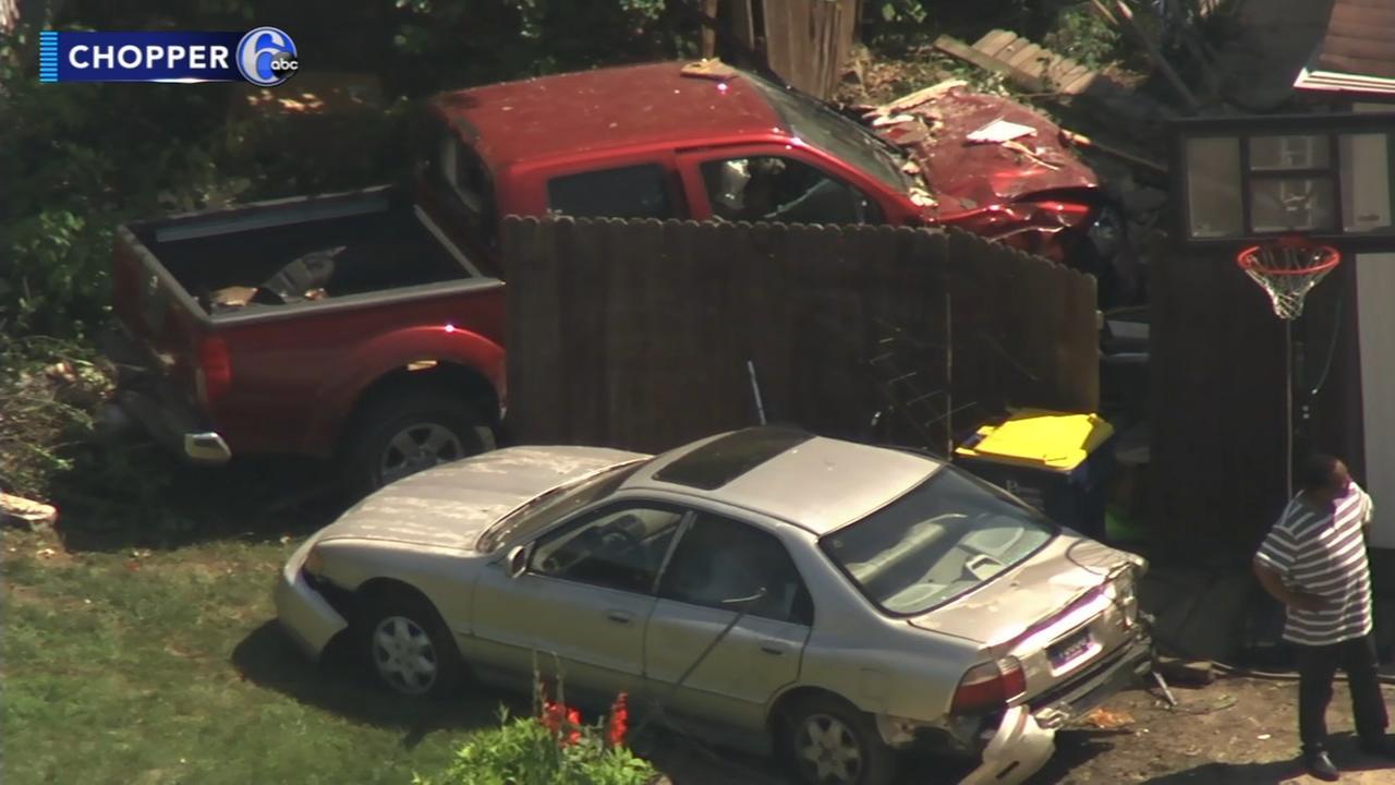 Crash sends car, pickup truck into houses in Del.