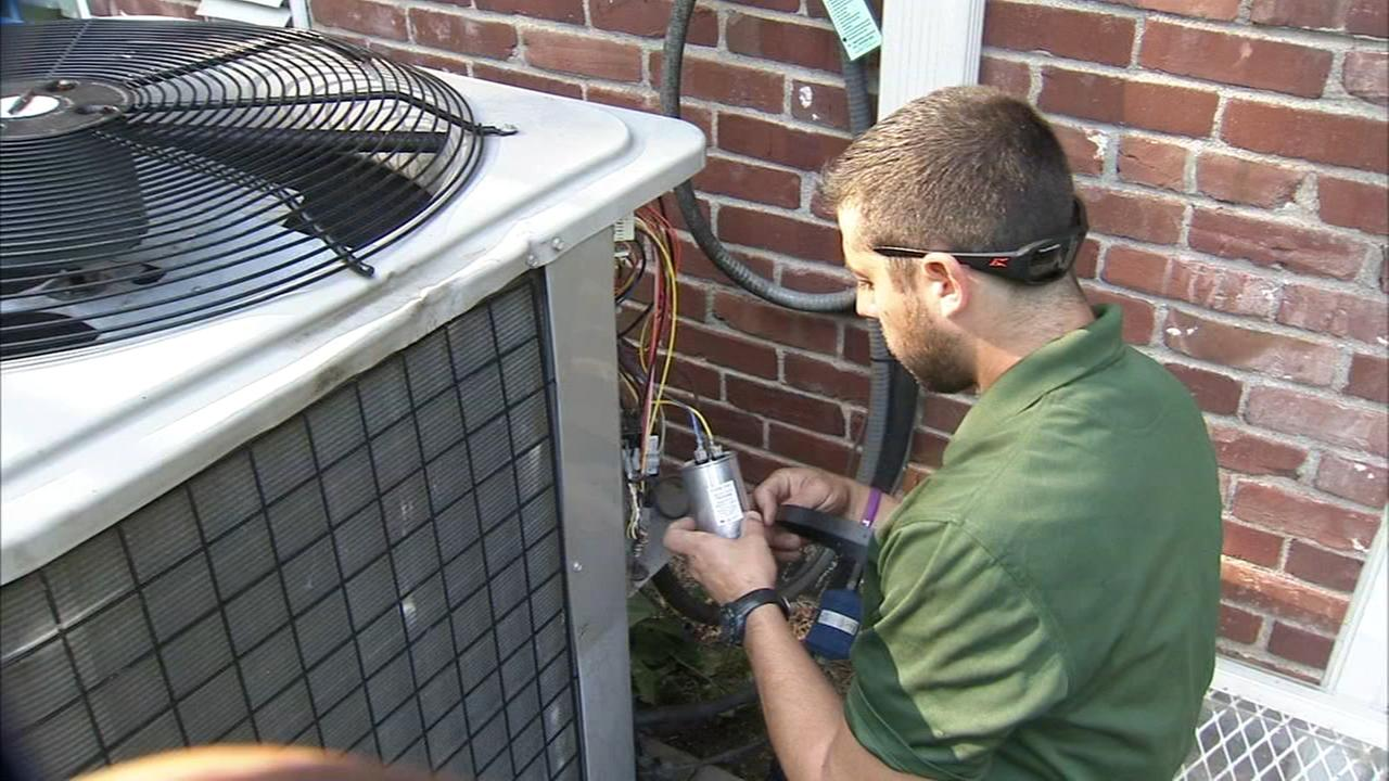 High temps mean busy days for A/C repairman
