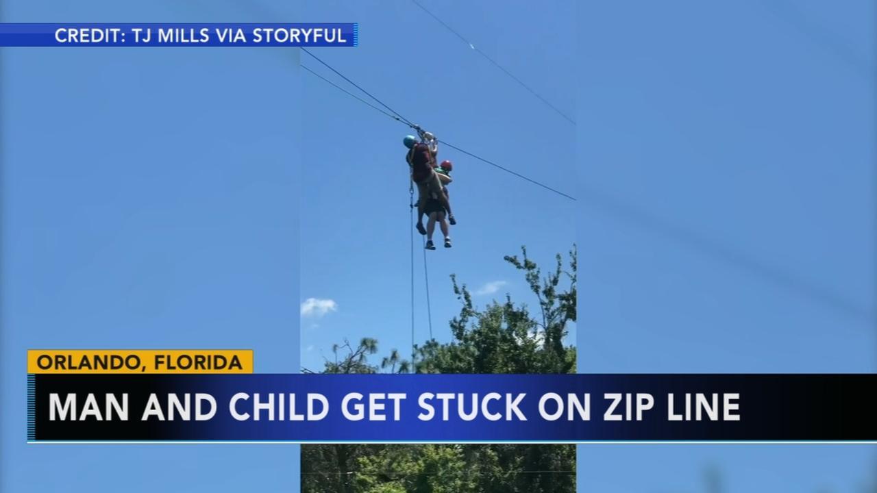 Man, child get stuck on zip line over alligators