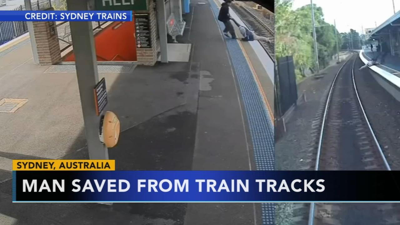 Man saved from train tracks