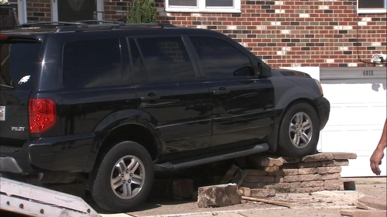 SUV lands on Holmesburg porch following accident