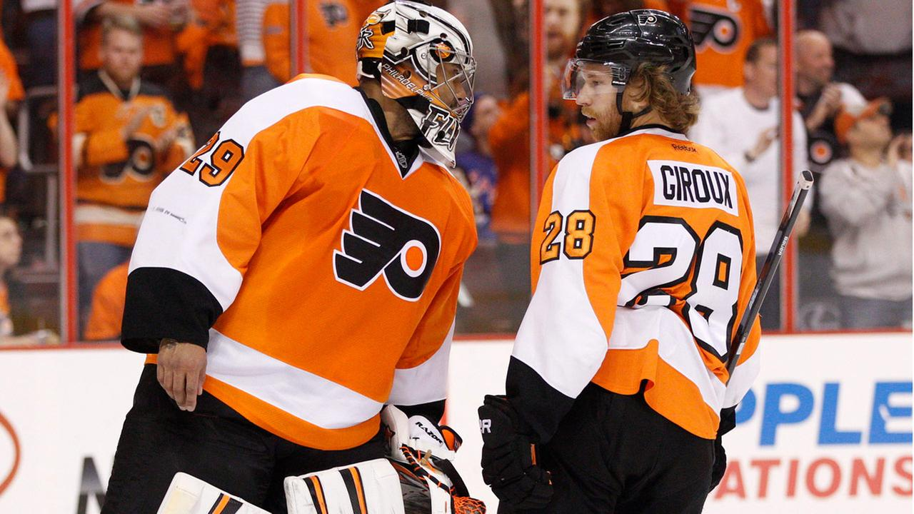 Flyers Ray Emery, left, talks with Claude Giroux , right, during the first period in Game 3 of an NHL hockey first-round playoff series against the New York Rangers April 2014.
