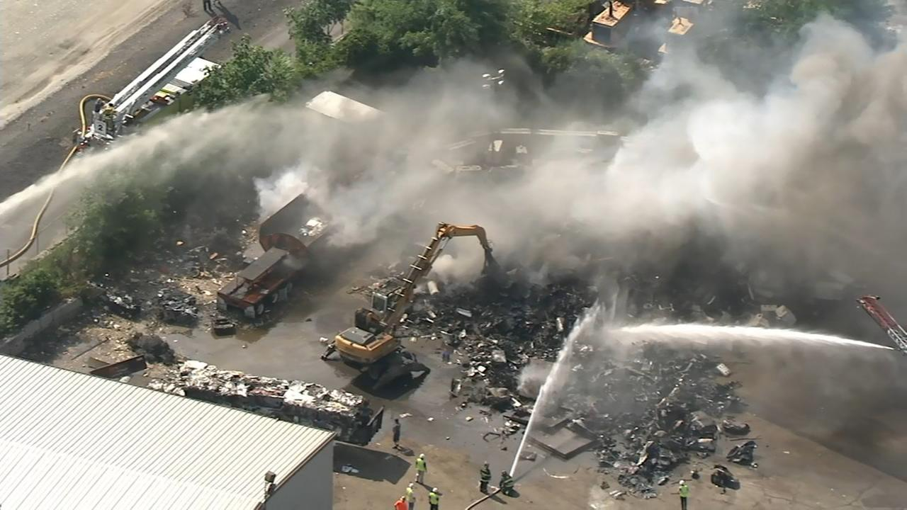 Chopper 6 over scrap yard fire in Darby Township
