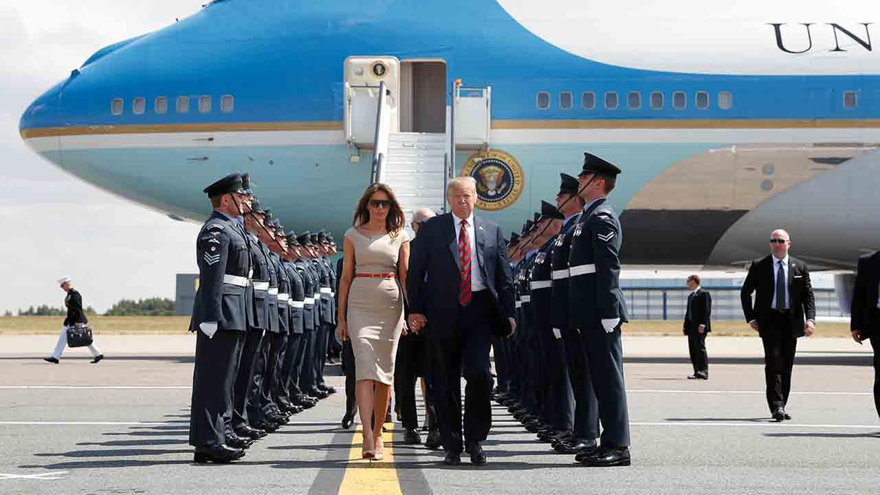 U.S. President Donald Trump and first lady Melania Trump step off Air Force One as they arrive at Londons Stansted Airport, Thursday, July 12, 2018.