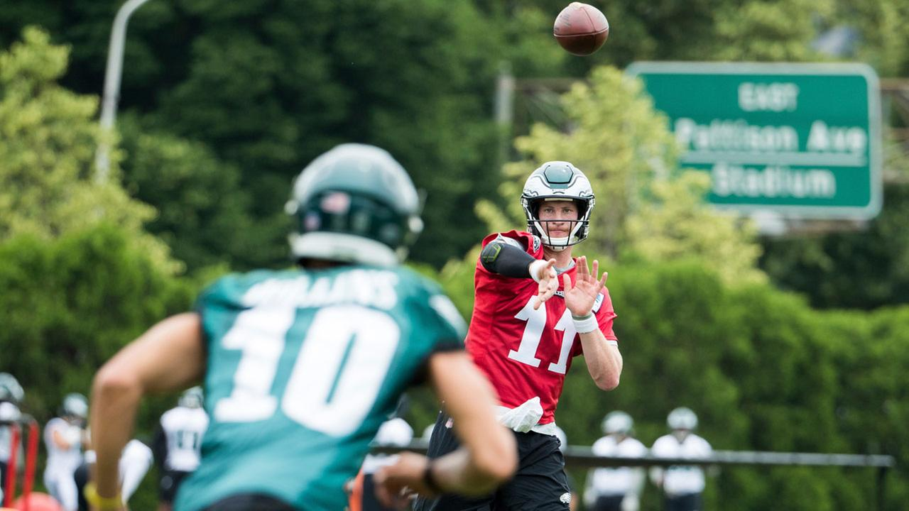 Philadelphia Eagles quarterback Carson Wentz, right, throws the ball to wide receiver Mack Hollins, left, during the practice at training camp, Wednesday, June 13, 2018.