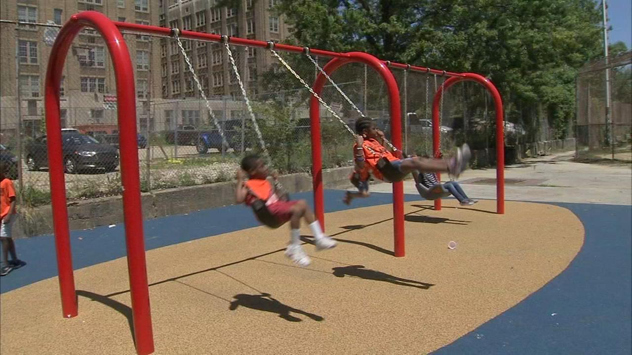 Climbing, swinging and jumping on brand new playground in North Philly