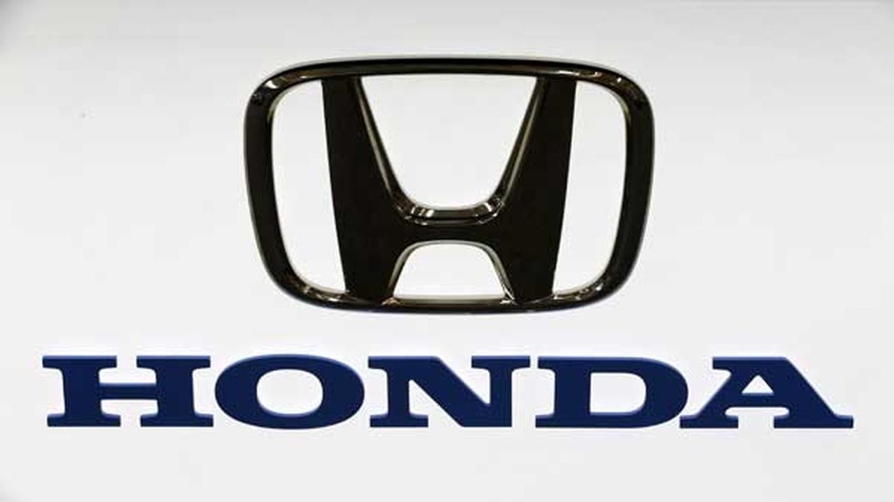 This Photo taken Feb. 14, 2013 shows a Honda logo at the 2013 Pittsburgh Auto Show in Pittsburgh. (AP Photo/Gene J. Puskar)
