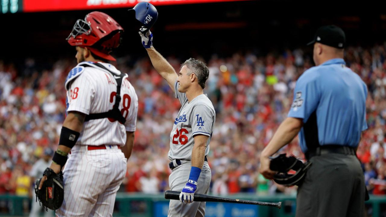 Los Angeles Dodgers Chase Utley, center, acknowledges the crowd before he bats during the second inning of a baseball game against the Philadelphia Phillies, July 23, 2018.