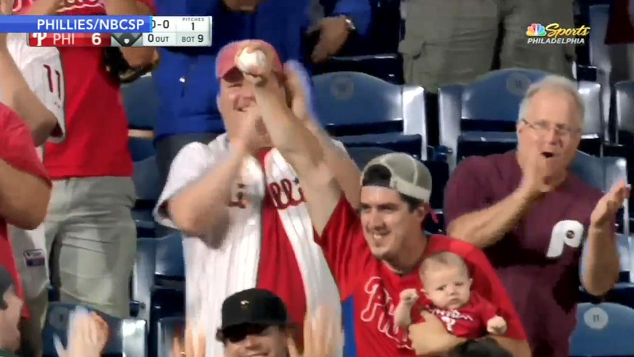 Oh baby! Phillies fan makes great catch while holding child