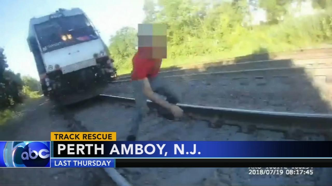 Officer rescues man from oncoming train