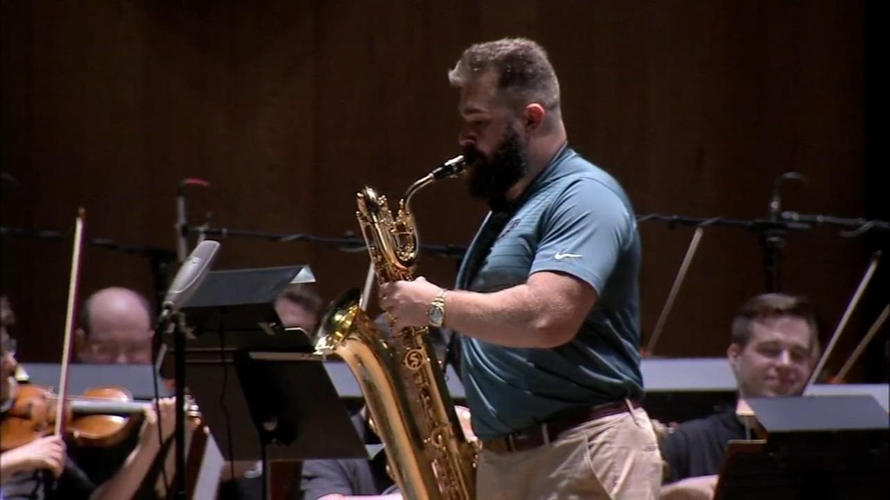 Kelce performs with orchestra, training camp begins