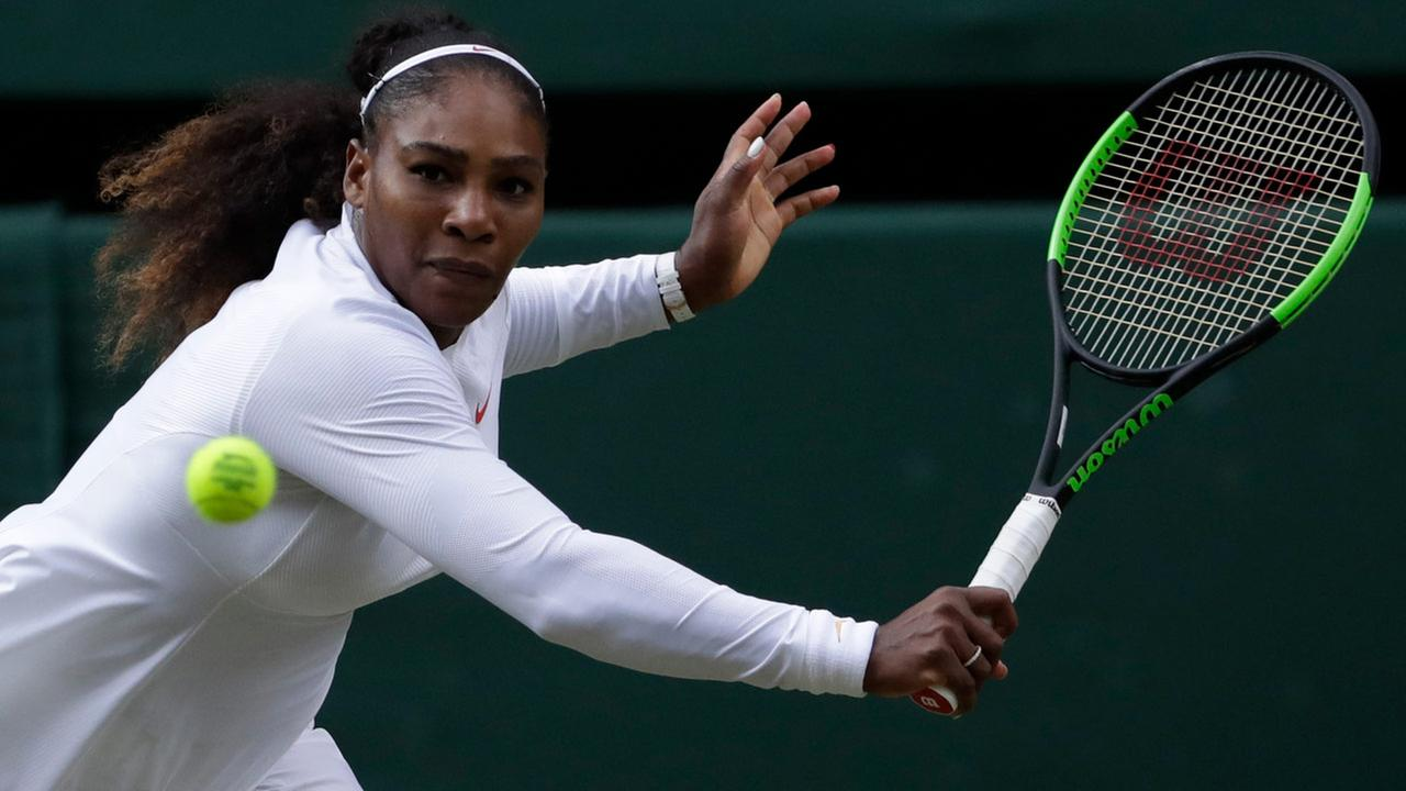 Serena Williams returns the ball to Germanys Angelique Kerber during their womens singles final match at the Wimbledon Tennis Championships, in London, July 14, 2018.