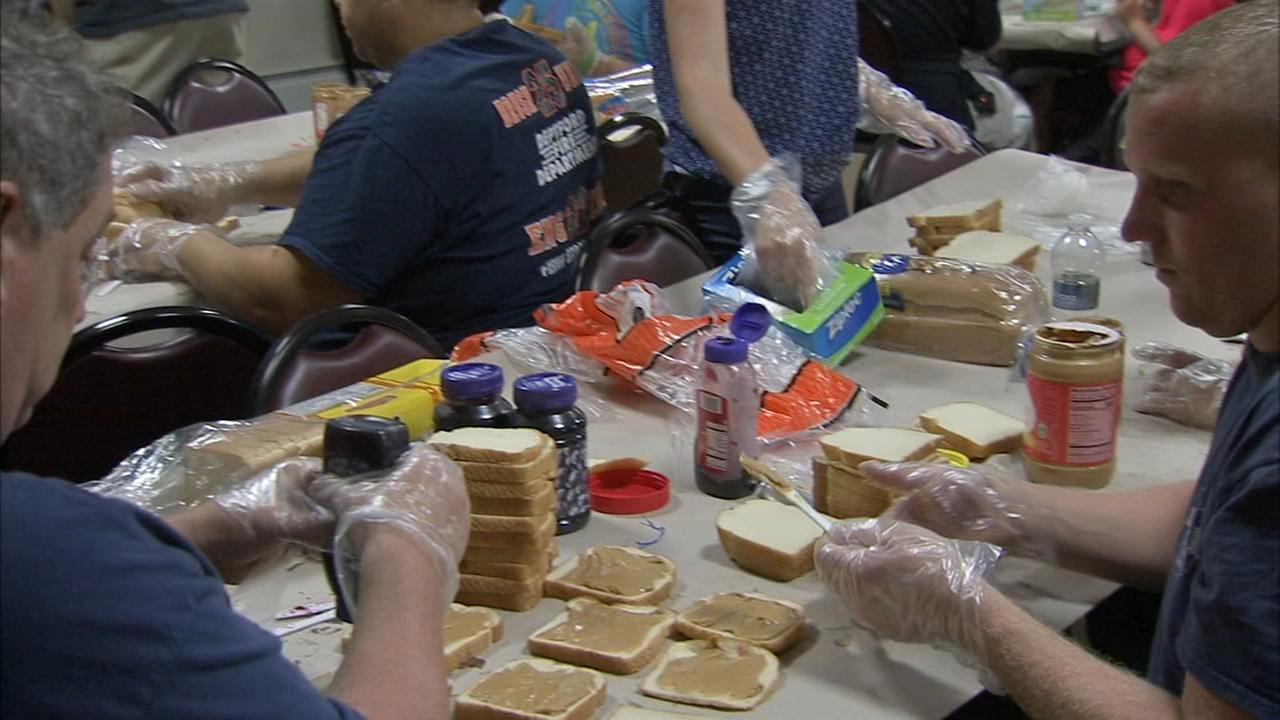 Deptford first responders make peanut butter and jelly sandwiches for the homeless