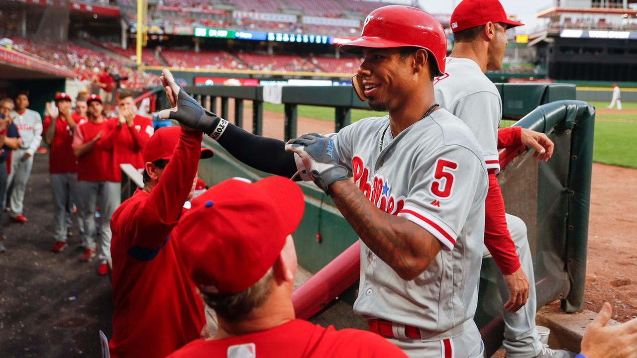 Phillies Nick Williams celebrates in the dugout after hitting a solo home run off Cincinnati Reds relief pitcher Michael Lorenzen during the third inning July 26, 2018.
