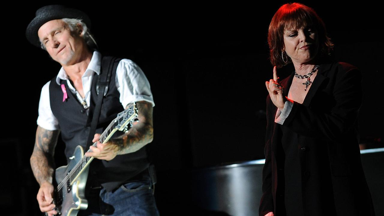 FILE: Neil Giraldo and Pat Benatar perform live in concert at the Cruzan Amphitheater on October 12, 2012 in West Palm Beach, Florida.