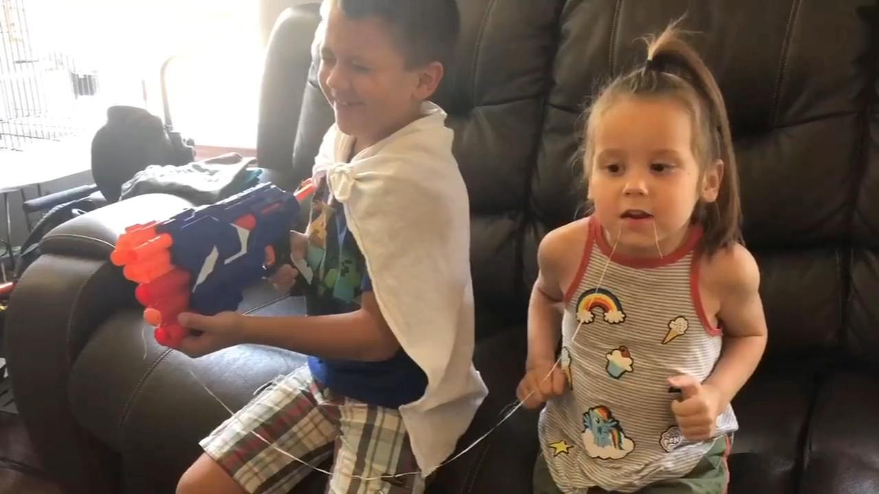 Boy helps pull his younger sisters tooth out with Nerf gun