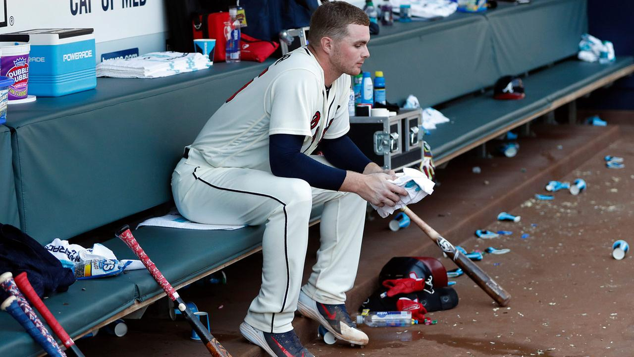 Atlanta Braves starting pitcher Sean Newcomb sits on the bench after losing his bid for a no-hitter in the ninth inning against the Los Angeles Dodgers, July 29, 2018, in Atlanta.