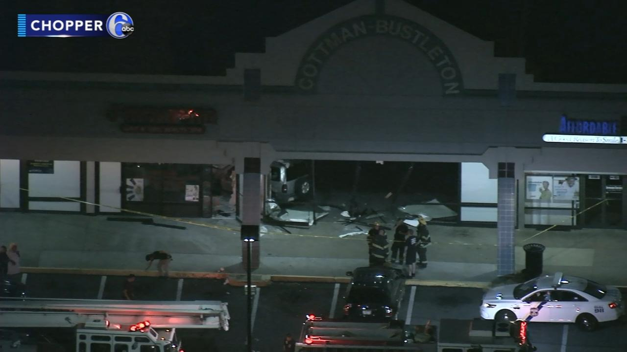 SUV crashes into strip mall in citys Rhawnhurst section