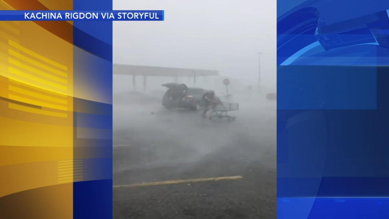 Woman returns shopping cart in storm