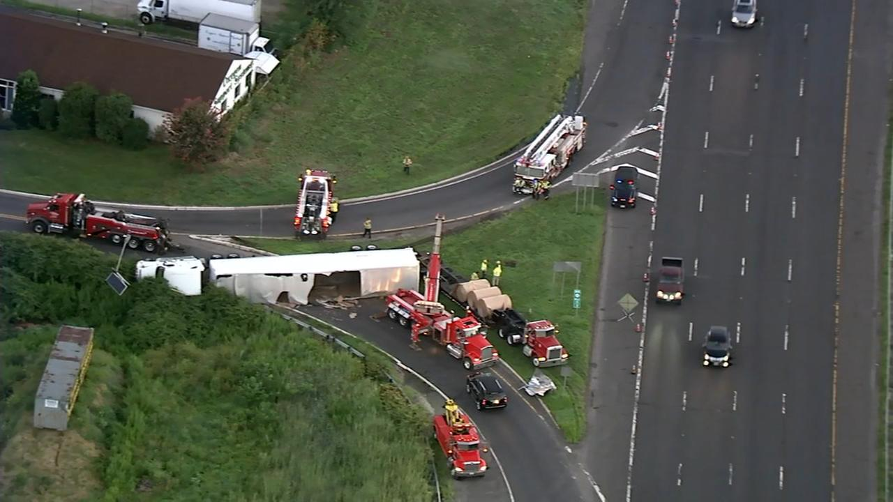 Truck carrying paper towels overturns
