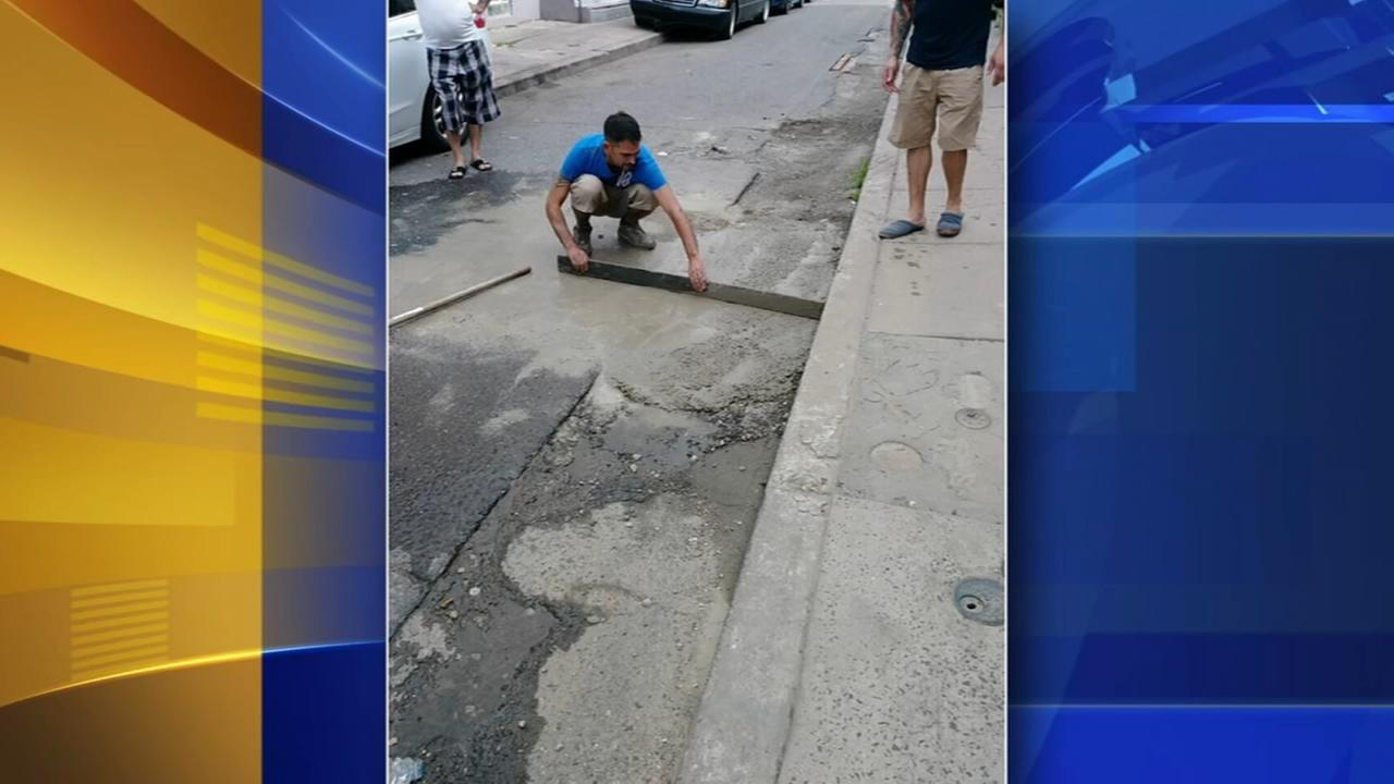 Neighbors come together to repair North Phila. street