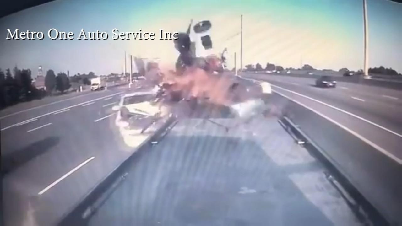 Caught on video: Car slams into truck stopped on highway