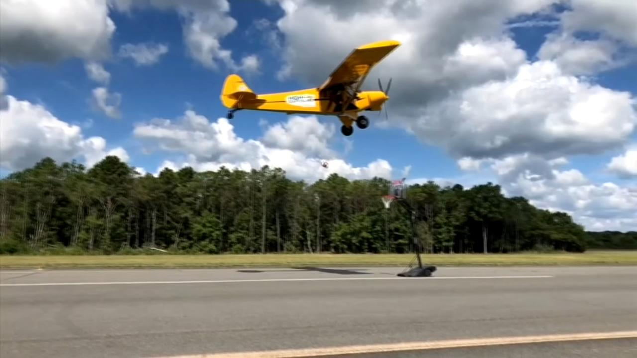 Harlem Globetrotter Bull Bullard makes trick shot out of plane near Wildwood