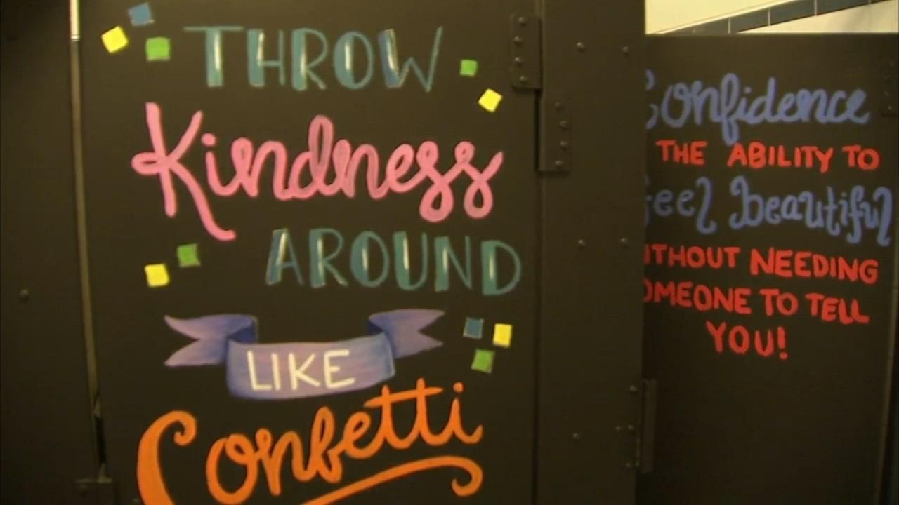 Delaware students spruce up their bathrooms with words of love