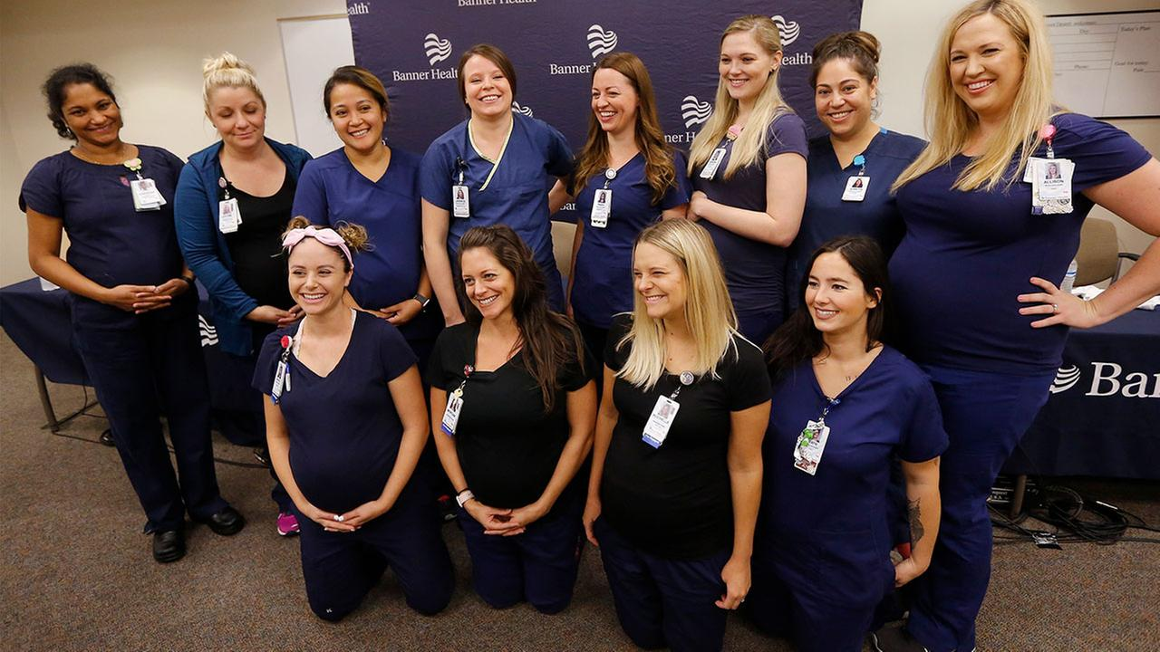 Most of the 16 pregnant nurses who work together in the ICU at Banner Desert Medical Center pose for a group photo, most of them are due to give birth between October and January.