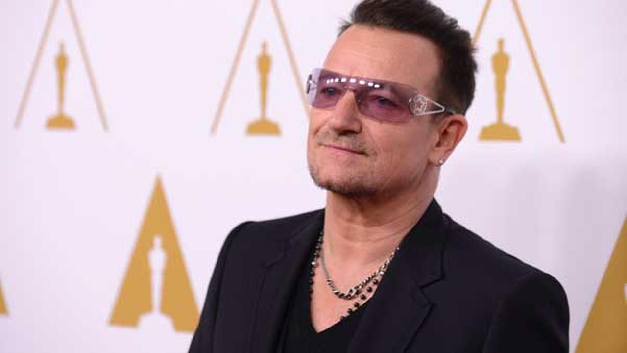 FILE - Bono arrives at the 86th Oscars Nominees Luncheon, on Monday, Feb., 10, 2014 in Beverly Hills, Calif. (Photo by Jordan Strauss/Invision/AP)