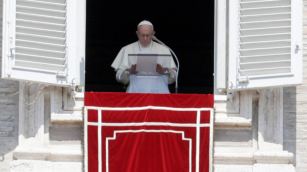 FILE - In this Sunday, Aug. 19, 2018 file photo, Pope Francis prays for the victims of the Kerala floods during the Angelus noon prayer in St.Peters Square, at the Vatican.