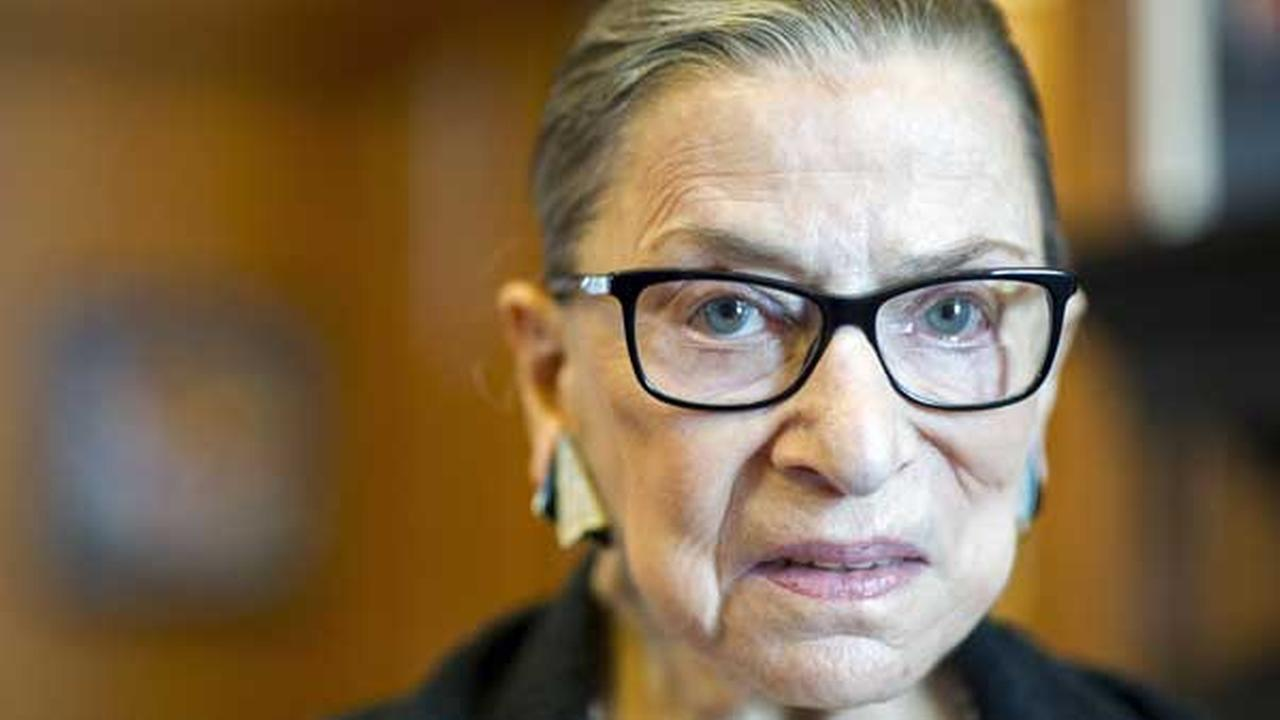 FILE - In this July 31, 2014 file photo is Associate Justice Ruth Bader Ginsburg in her Supreme Court chambers in Washington.