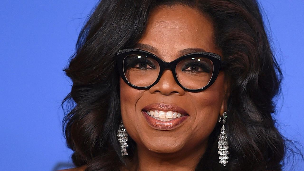 FILE - In this Jan. 7, 2018, file photo, Oprah Winfrey poses in the press room with the Cecil B. DeMille Award at the 75th annual Golden Globe Awards in Beverly Hills, Calif.