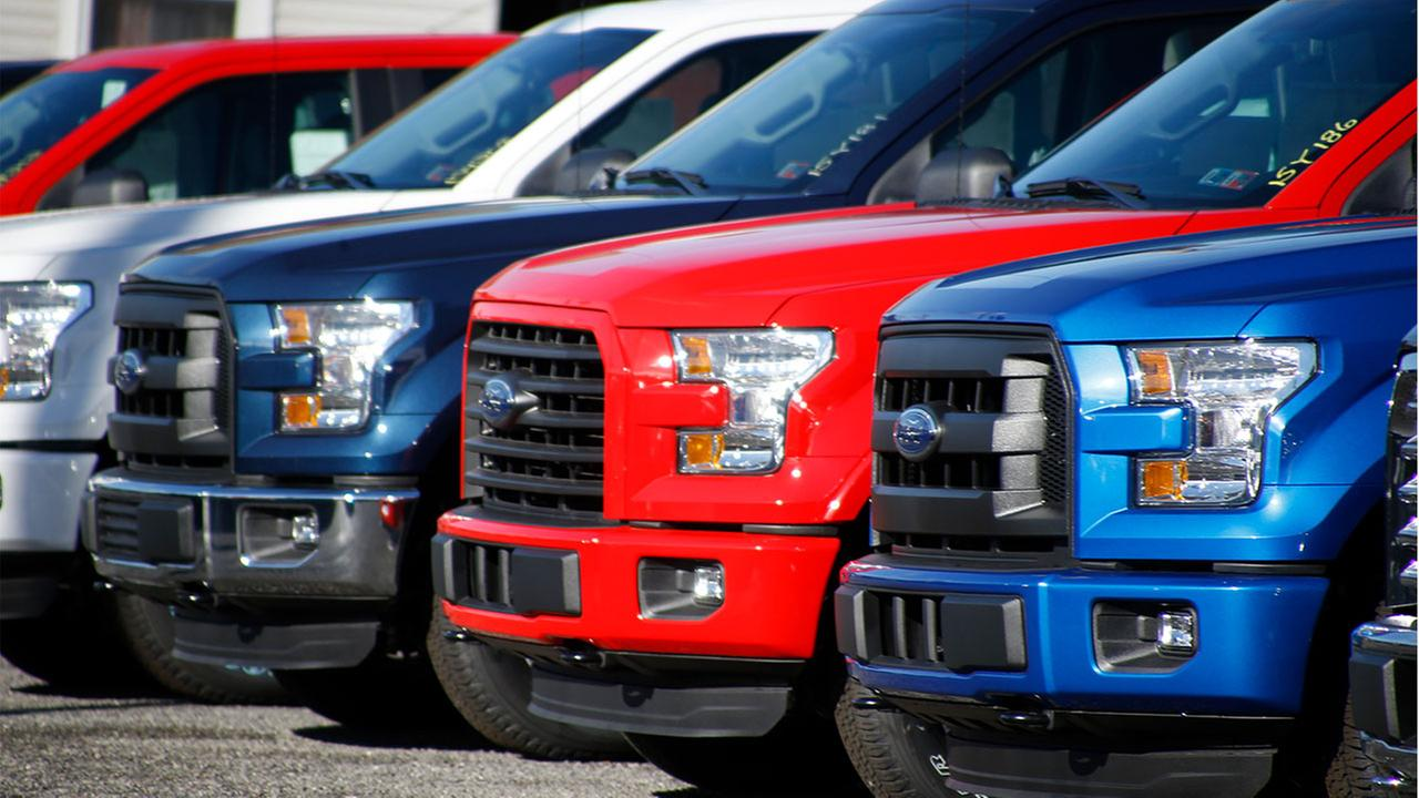 Under pressure from U.S. safety regulators, Ford is recalling about 2 million F-150 pickup trucks in North America because the seat belts can spark and cause fires.