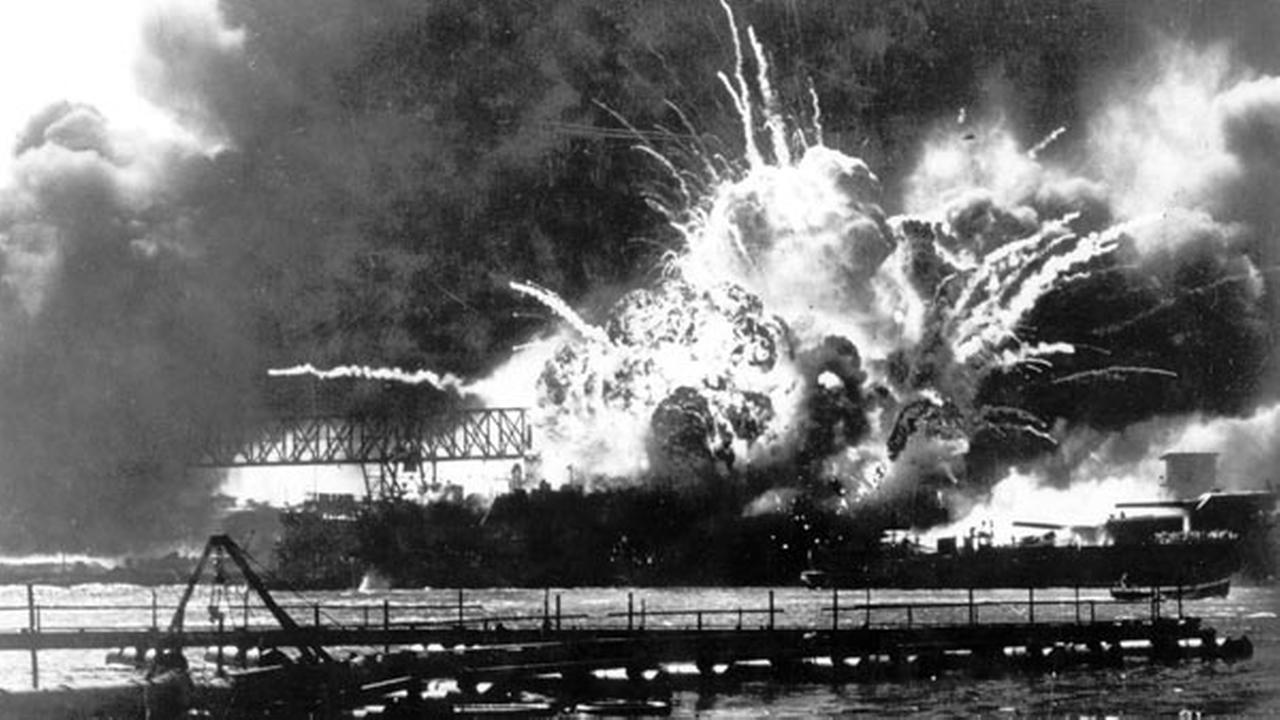 FILE - In this Dec. 7, 1941 file photo, the destroyer USS Shaw explodes after being hit by bombs during the Japanese surprise attack on Pearl Harbor, Hawaii.