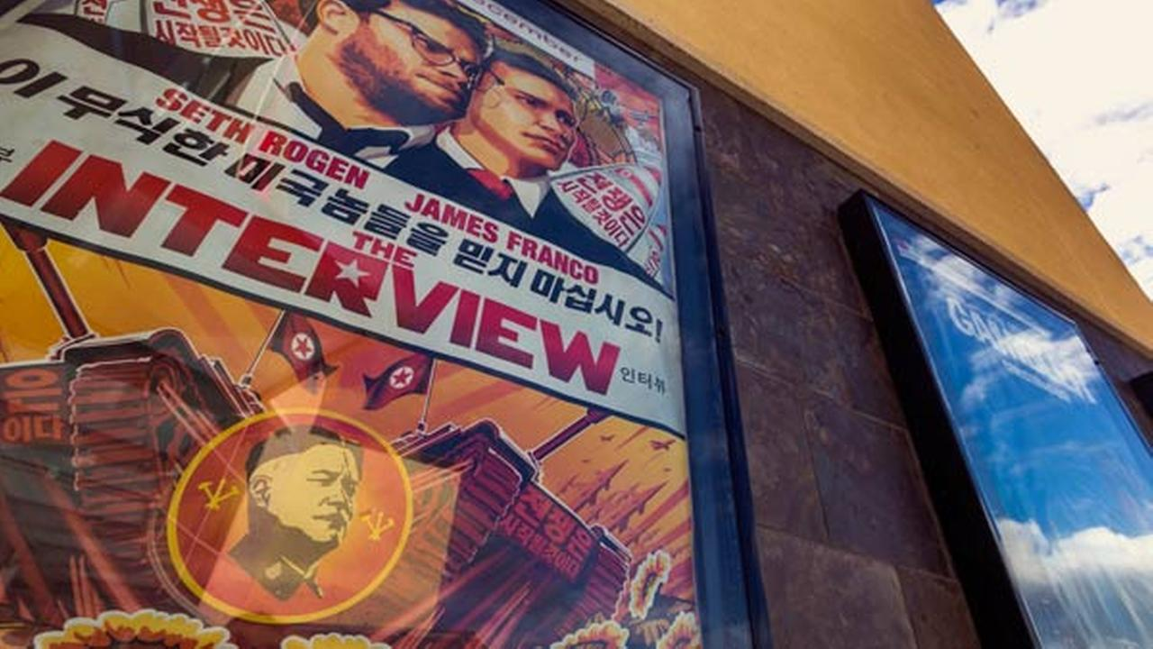 A movie poster for the movie The Interview is displayed outside the AMC Glendora 12 movie theater Wednesday, Dec. 17, 2014, in Glendora, Calif.