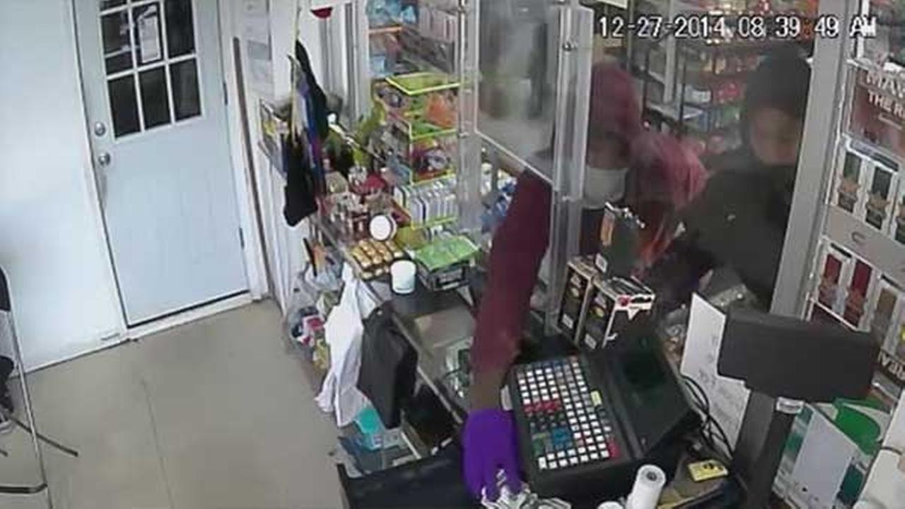 Police are looking for two armed suspects who robbed a food market in North Philadelphia.