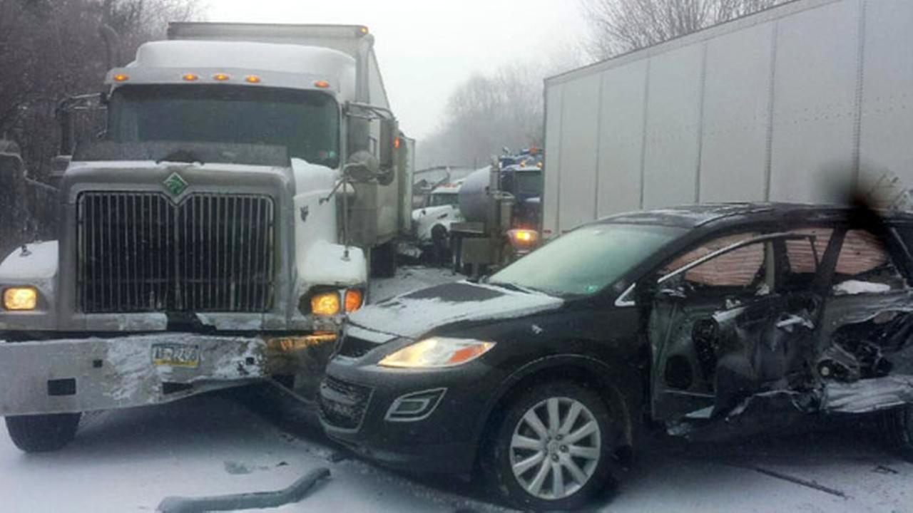 In this photo provided by exploreClarion.com/Bauer Truck Repair, vehicles remain at the scene of a fatal 18-vehicle pileup that occurred in whiteout conditions.