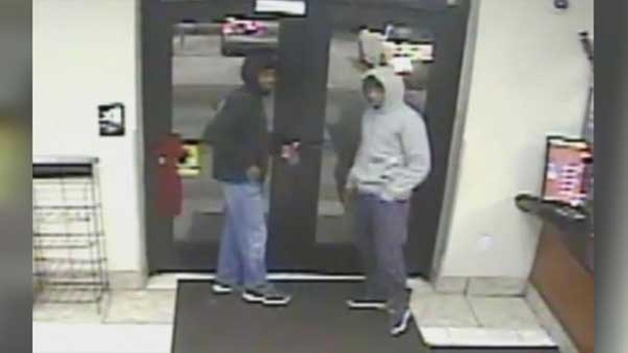 Philadelphia police are searching for two suspects who robbed a woman at gunpoint in the citys Strawberry Mansion section.