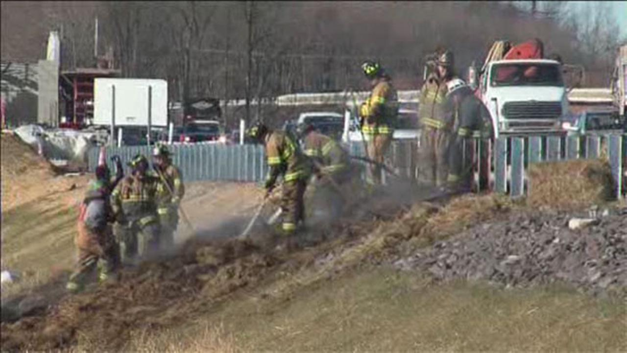 Truck loaded with hay catches on fire