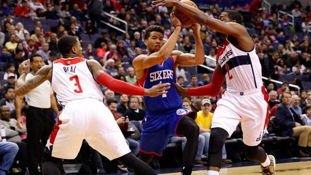 Philadelphia 76ers guard Michael Carter-Williams (1) tries to drive between Washington Wizards guard Bradley Beal (3) and guard John Wall (2)