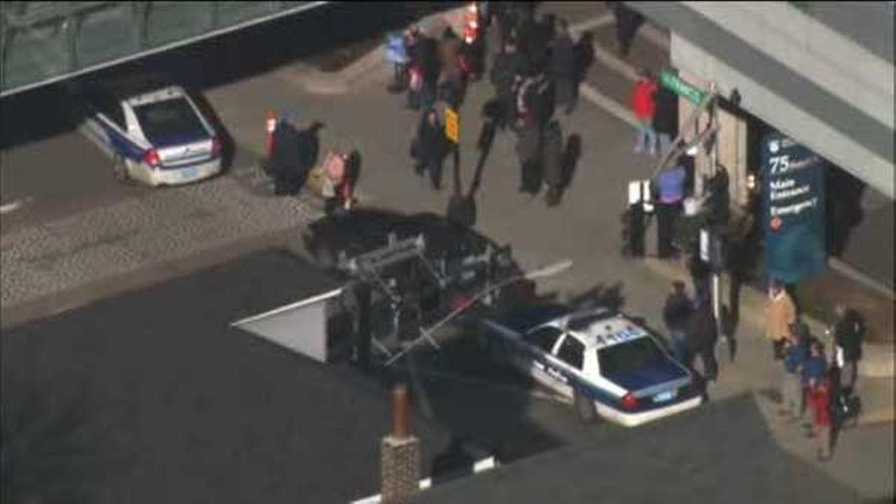 A person was critically shot at a hospital Tuesday and a suspect was in custody, Boston police said.